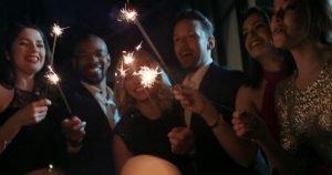 friends light up at an event