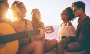 Friends on the beach - marijuana builds connection and creativity