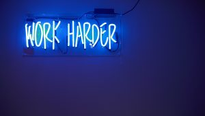 Work harder neon sign